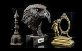 Cast Bronze Head of an Eagle, mounted on a square plinth, 8 inches (20cms) high,