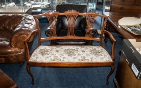 Edwardian Mahogany Two Seater Salon Sofa with a delicate fretworked splat back, and shaped arms,