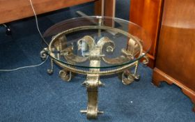"""A 1960's Brutalist Wrought Iron Gilded Glass Topped Coffee Table, 36"""" diameter x 18"""" high,"""