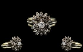 18ct White Gold - Attractive Diamond Set Ring - Flower head Design. Marked 18kt.