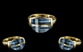 18ct Gold - Attractive and Good Quality Blue Topaz Set Dress Ring.