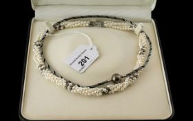 Four Strand Twist Pearls, by Whittles Jewellers of Preston, in presentation case. Together with a