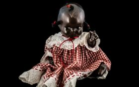 Antique African American Unsigned Girl Doll with Composition Limbs, Measures 9 Inches High When Sat,