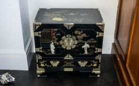 A Chinese Black Lacquered Cabinet, painted floral gilt decoration in enamels,