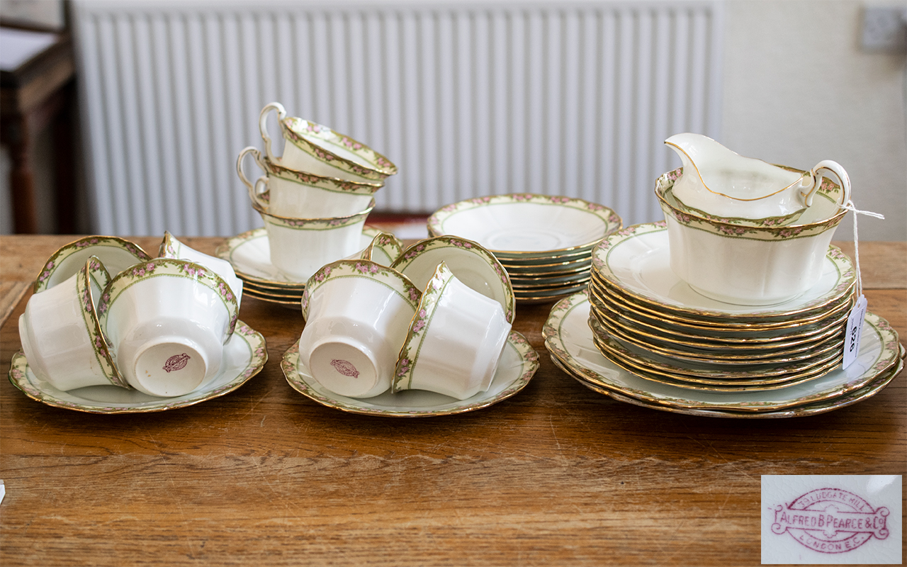 Tea Service by Alfred Pearce & Co of London, comprising eleven tea cups, saucers and side plates;