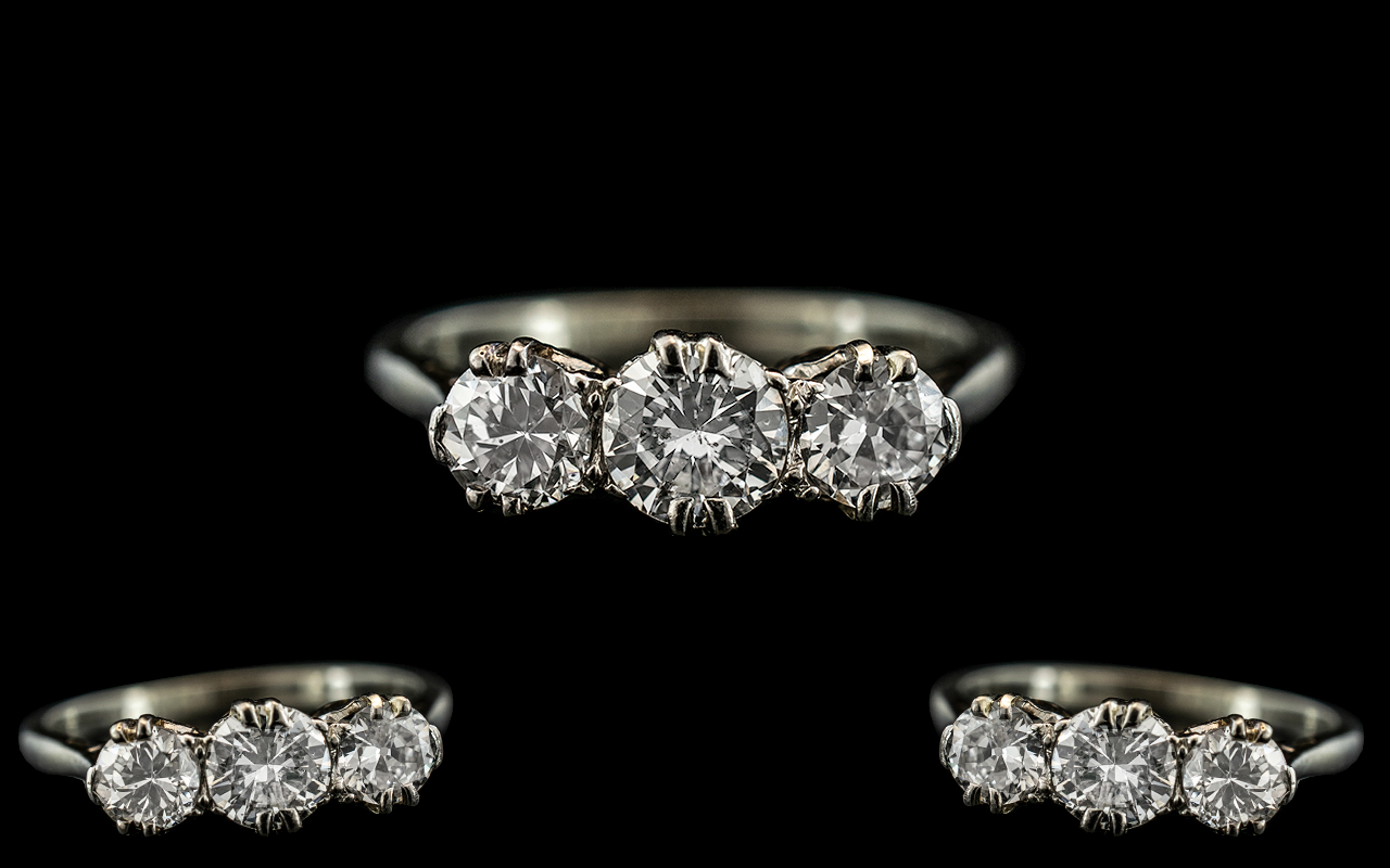 18ct White Gold and Platinum 3 Stone Diamond Set Ring. Marked 18ct and Platinum to Interior of