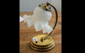 A Stunning Art Deco Period Lamp with Chrome lady holding pink glass shell-shaped shade.
