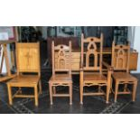 Four Oak Ecclesiastical Chairs, consisting of an armchair and three stand chairs in the reformed