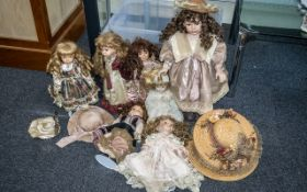 Collection of Seven Dolls dressed in Victorian fashions with stands, together with five straw hats