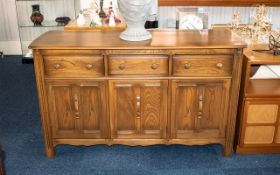 Ercol Dresser of Typical Style with three frieze drawers above cupboard space, 34 inches (app.85cms)