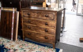 A Mahogany Late Georgian Chest of Drawers, with a fitted top drawer with a moulded front,
