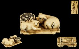 Japanese Meiji Period Carved Ivory Netsuke of unusual form depicting a sow with her piglet sitting