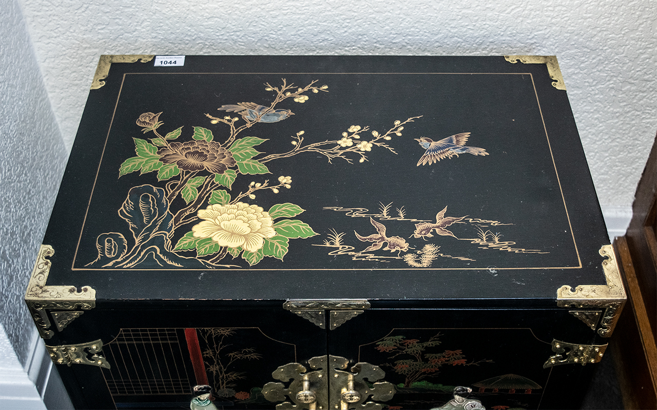 A Chinese Black Lacquered Cabinet, painted floral gilt decoration in enamels, with two door front - Image 2 of 2