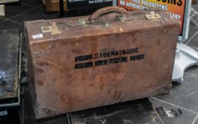 A Vintage Brown Leather Suitcase