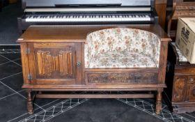 A Mid 20th Century Oak Telephone Seat, w