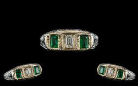 Antique Period - Attractive Platinum Pave Set 3 Stone Emerald and Diamond Dress Ring.