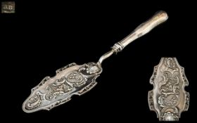 An Antique 19th Century Austrian Fish Slice - Embossed Shell & Floral with Cherub and Sea God.