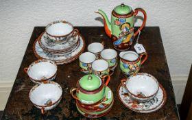 Two Japanese Tea Sets, comprising an eggshell tea set with a tea pot, sugar bowl, milk jug,