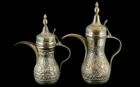 Two Middle Eastern Embossed Coffee Pots, With Finial Lids, 12 & 10 Inches. Stamped to Base G.