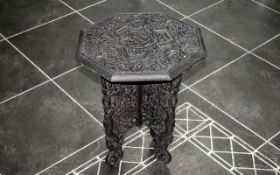 """Small Carved Wooden Oriental Table, fold up, 17"""" tall x 15"""" table top diameter."""