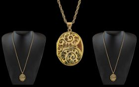 Ladies - Excellent Quality 9ct Gold Oval Shaped Hinged Locket with Chased Decoration to Front Cover,