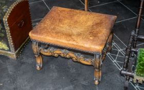 A William & Mary Style Cabriole Leg Stool with a leather seat, worn, with brass studs. Height 14''.