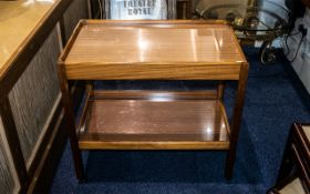 """A Teak Two Shelf Trolley 1950's, raised on square legs with casters, height 26.5"""" x 29."""
