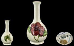 Moorcroft Handpainted Tubelined Bottle Shaped Vase 'Hibiscus' Design, on cream ground.