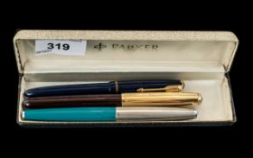 Collection of Parker Fountain Pens, comprising a dark blue Parker with a 14k nib,
