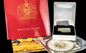 Buckingham Palace Interest - A Limited Edition Enamel Box, the hinged lid showing an image of