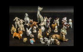 A Collection of Decorative Animal Figures Includes 17 x Various China / Porcelain Dogs, 1 x Cat,