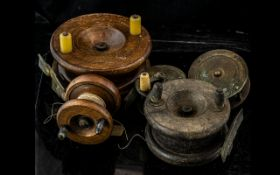 Five Vintage Fishing Reels comprising three various sizes of wooden reel,