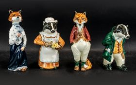 Cinque Ports Pottery Figures, four in total, comprising Mrs Badger, Mr Badger, Mrs Fox and Mr Fox.