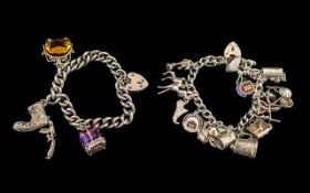 A Vintage Sterling Silver Charm Bracelet Loaded with 13 Silver Charms. All Marked for Silver 925.