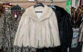 Ladies Mink Jacket, hip length, two slit pockets, collar and reveres, scalloped hem.