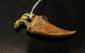 Unusual Antique Brass Vesta Case in the form of a tiger claw,