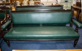 Pair of Antique Mahogany Framed Green Leather Club Sofas with open arms, supported on turned legs,