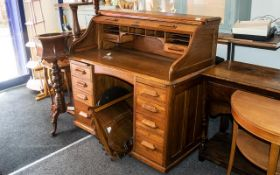 Golden Oak 'S' Shaped Shuttered Front Roll-Top Desk, by the Lebus Company. Desk with a fitted