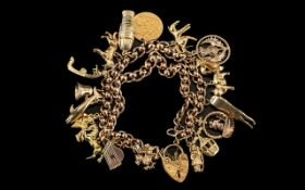 Ladies 9ct Gold - Rolla Ball Charm Bracelet - Loaded with ( 19 ) Excellent 9ct Gold Charms + A 22ct