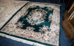 Large Green Ground Embossed Chinese Carpet with a decorative floral border; in good condition,