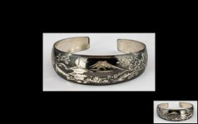 Japanese Silver Bangle with Temple and Mountain Decoration. Hallmarked for Silver.