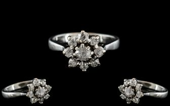 18ct White Gold - Attractive Diamond Set Cluster Ring - Flower head Setting. Marked 18ct to Interior