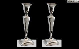 Elizabeth II Pair of Sterling Silver Candlesticks of Pleasing Proportions.