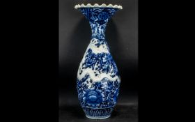 Large Japanese Meiji Period Blue and White Decorated Fishtail Shape Vase with a raised, moulded,