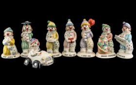 Collection of Small Beswick Clown Figures, comprising LL7 Clown in car, LL4 'Just for You',