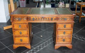 A Modern Twin Pedestal Desk, two banks of three drawers, and three frieze drawers,