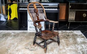 Antique Yorkshire Knuckle -Arm Windsor Chair of traditional form, with a shaped fiddle back splat,