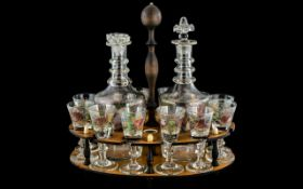 Collection of Antique Decorated Liqueur Glasses & Decanters, housed in a wooden stand, comprising