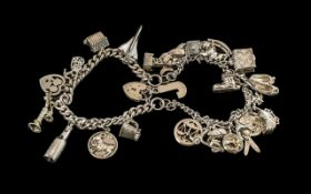 Vintage Sterling Silver Charm Bracelets - Loaded with Over 26 Silver Charms.
