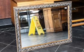 """A Rectangular Bevelled Glass Mirror, with moulded acanthus frame. Measures 30"""" x 42""""."""